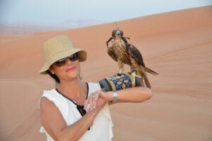 Mariella withe the Falcon in the Sahara