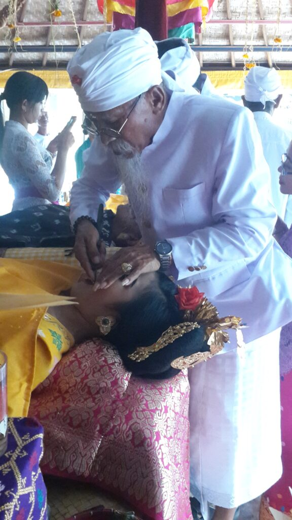 The tooth filing ceremony administered by the Pemanku